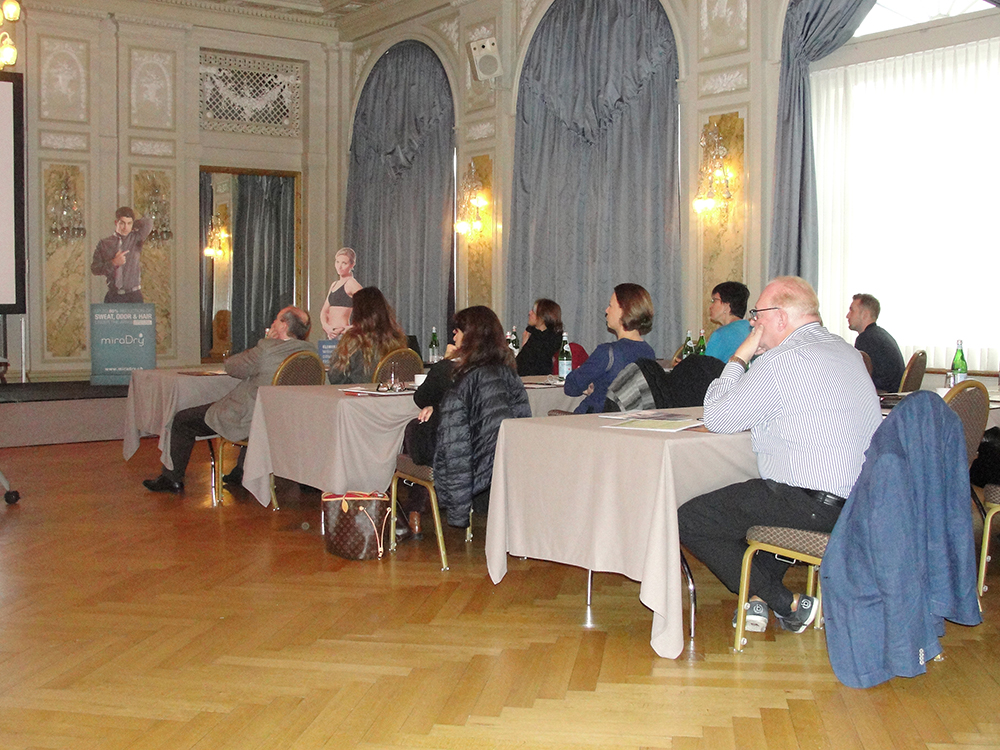 Concentrated listeners during the presentation of Dr. Matteo Tretti